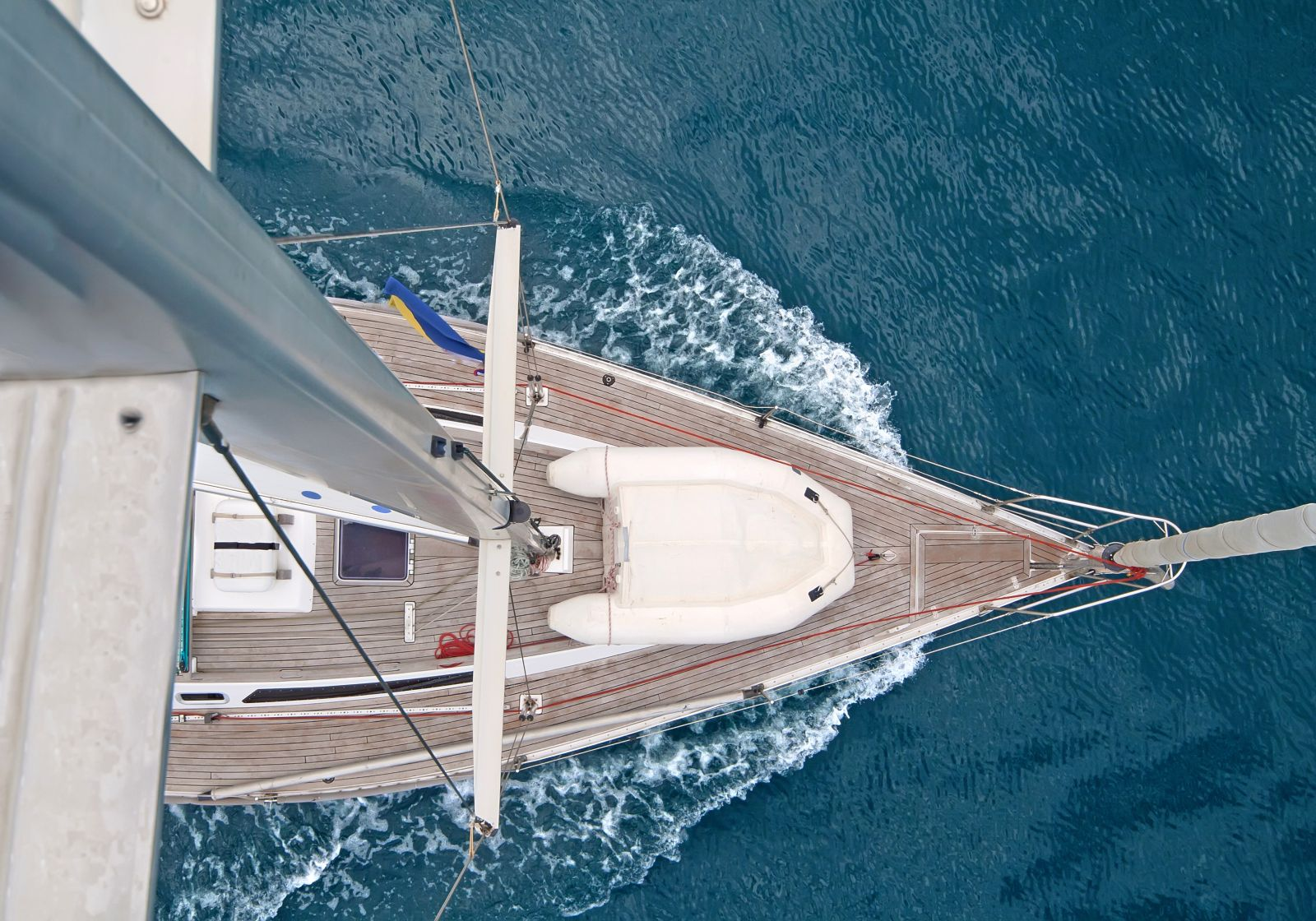 Top view of sailing boat with water splash