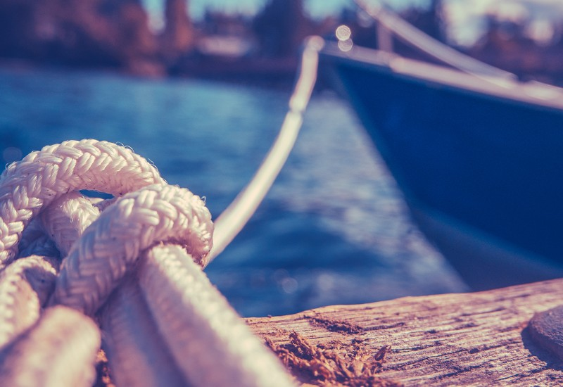 the difference between mooring, docking and berthing